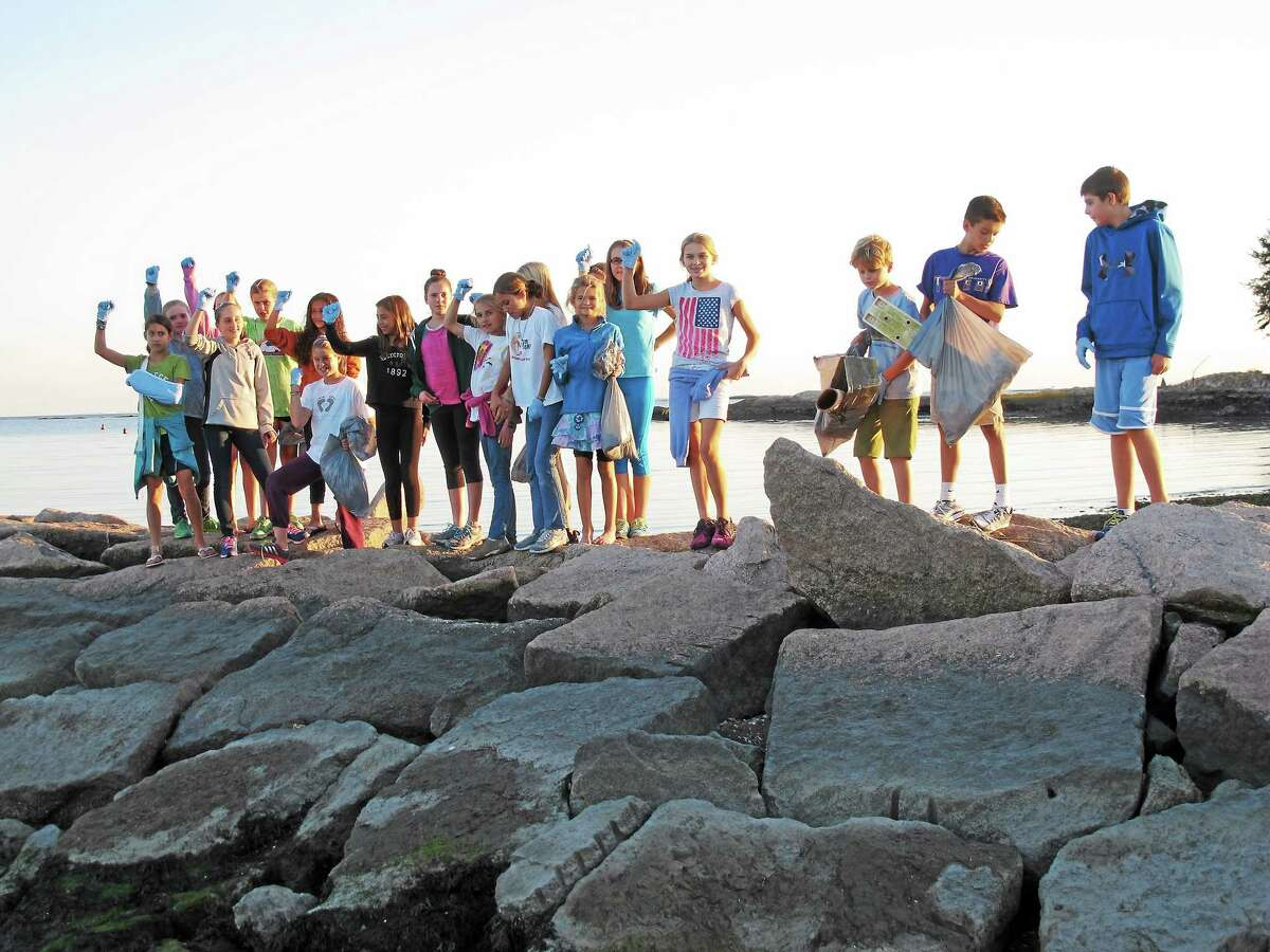 """""""Waves of Freedom,"""" an informal club, run by three sixth-graders from Baldwin Middle School hosted a beach clean-up event at Guilford's Jacobs Beach, in conjunction with Guilford's Clean Up Day in 2014."""