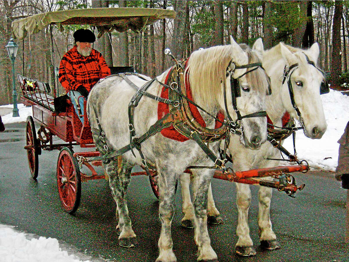 Contributed photoHorse-drawn carriage rides are part of the entertainment at the Wadsworth Mansion on Jan. 1.