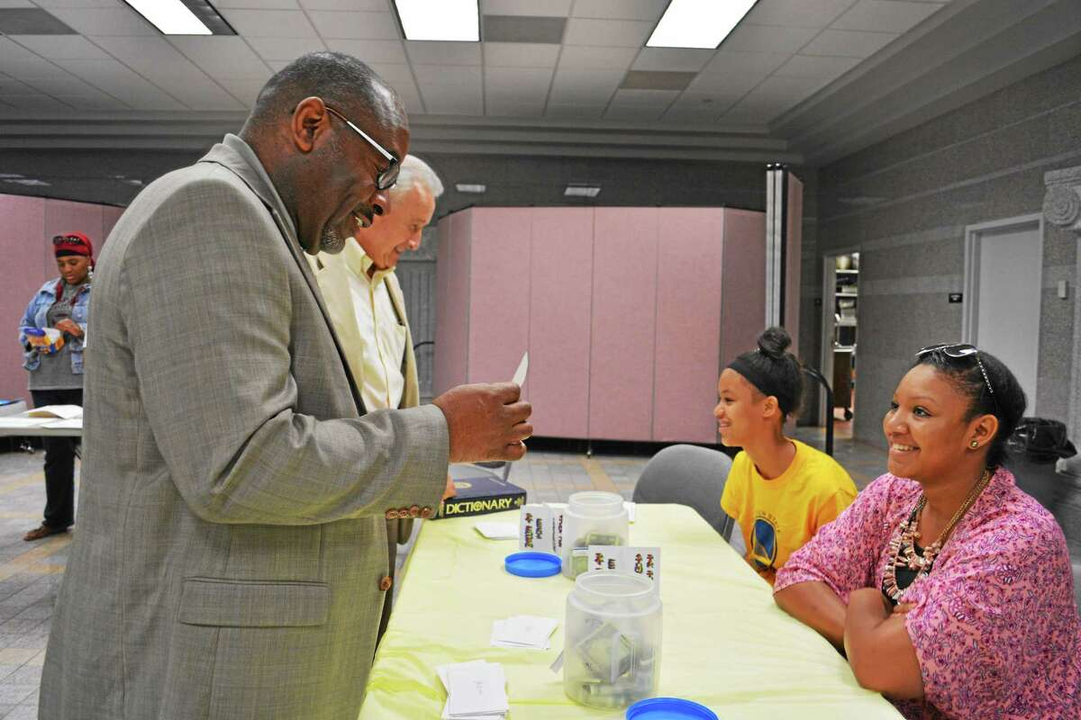 The Rev. Moses Harvill and Middletown Board of Education member Vincent Loffredo quiz Cheyenne Trinidad and Sharae Henderson on the meaning of words Tuesday night.