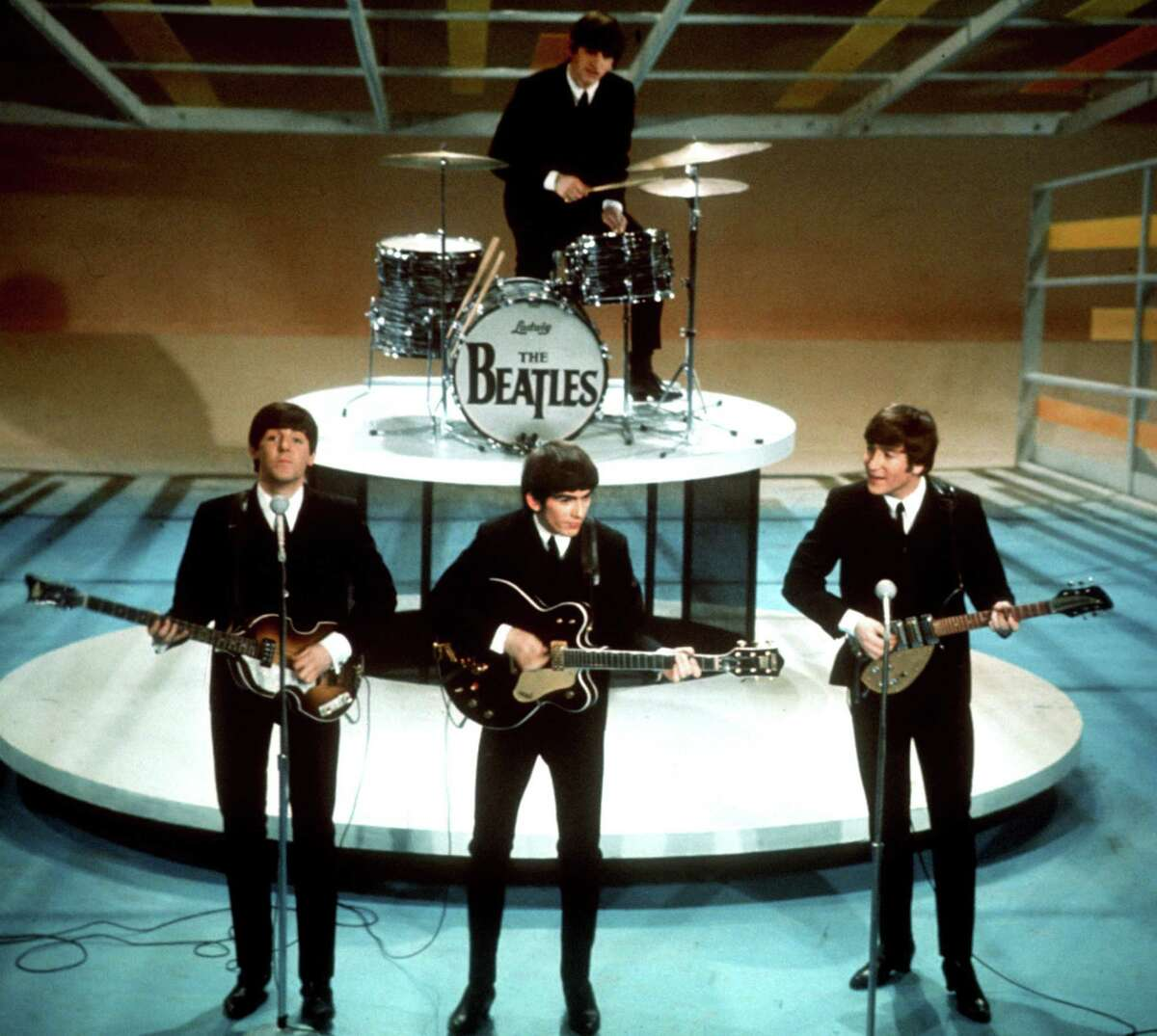 """In this Feb. 9, 1964 file photo, The Beatles perform on the CBS """"Ed Sullivan Show"""" in New York. \"""
