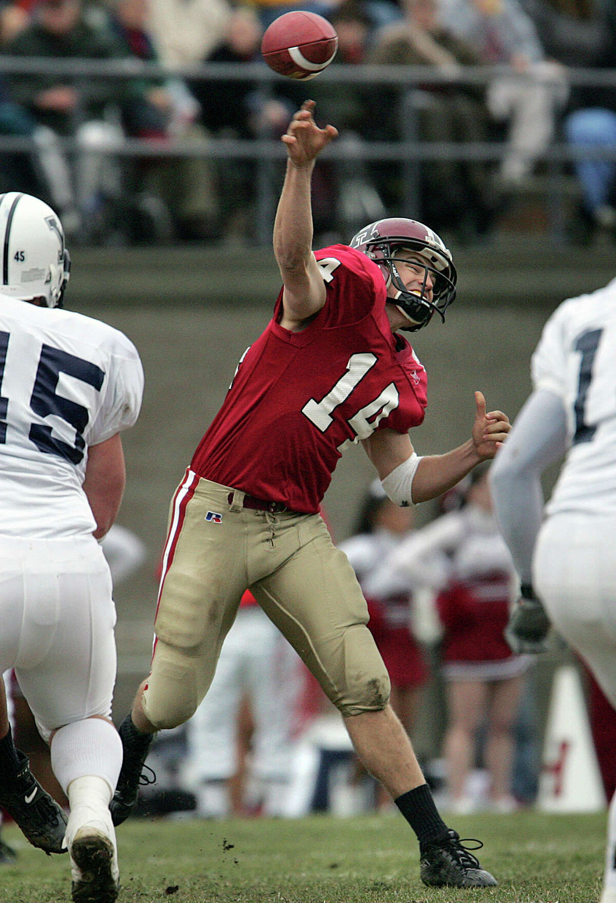 FILE - In this Saturday, Nov. 20, 2004 file photo, Harvard quarterback Ryan Fitzpatrick (14) throws long against Yale in the first quarter in Boston. Ryan Fitzpatrick has played in huge games before, so pressure is no big deal to the Jets quarterback. New York against New England this Sunday, Dec. 27, 2015? Try Harvard-Yale, 2004. (AP Photo/Michael Dwyer, File)
