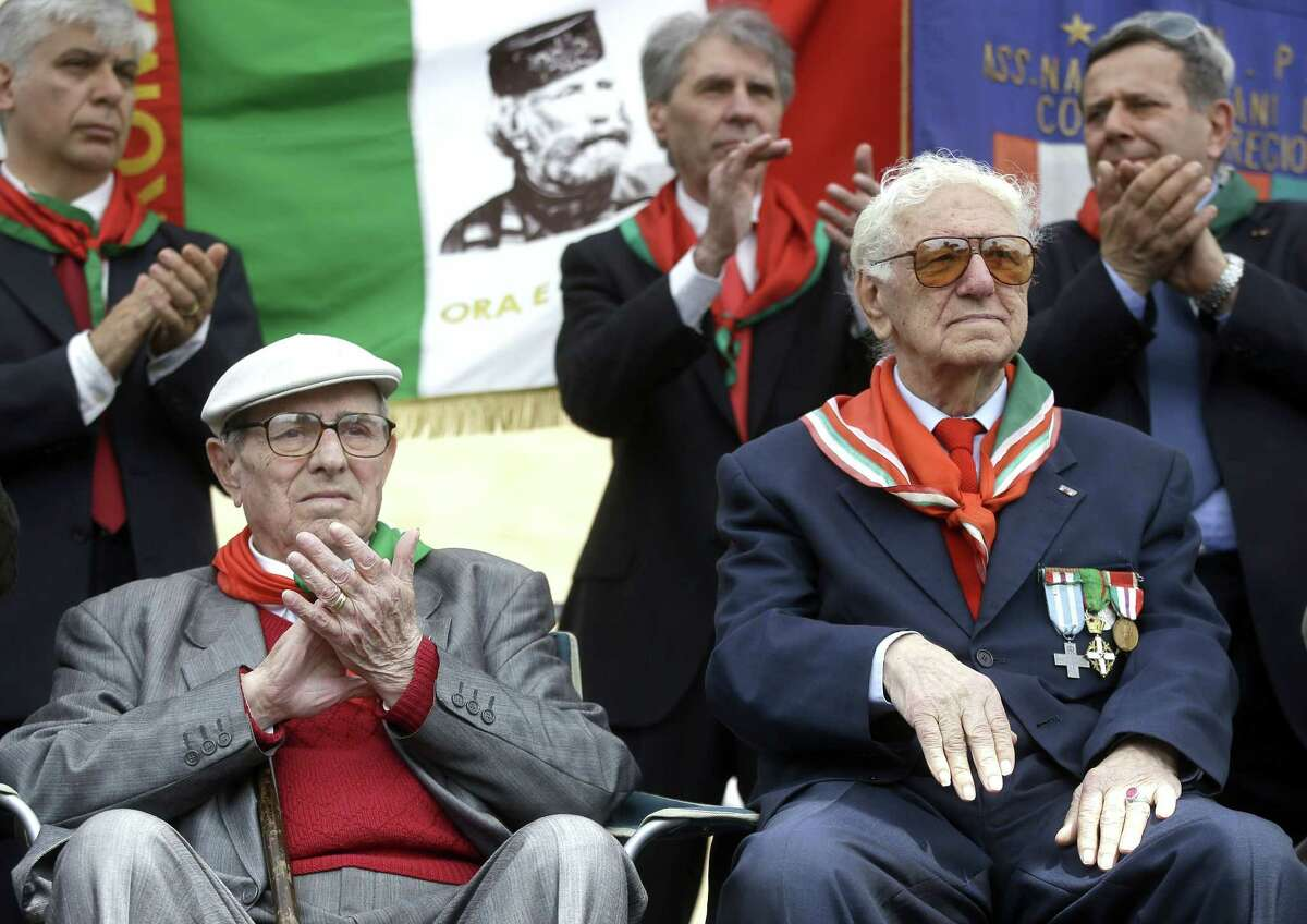 Italian partisans Ivo Maggi, left, and Sante Merenna attend a ceremony to celebrate the liberation day in Rome, Saturday, April 25, 2015. Italy on Saturday celebrated the 70th anniversary of a partisan uprising against the Nazis and their Fascist allies at the end of World War II. The anniversary marks the day in 1945 when the Italian resistance movement proclaimed an insurgency as the Allies were pushing German forces out of the peninsula. (AP Photo/Gregorio Borgia)