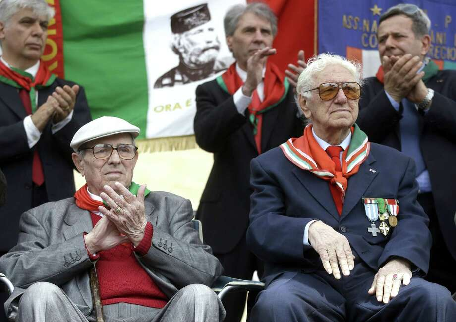 Italian partisans Ivo Maggi, left, and Sante Merenna attend a ceremony to celebrate the liberation day in Rome, Saturday, April 25, 2015. Italy on Saturday celebrated the 70th anniversary of a partisan uprising against the Nazis and their Fascist allies at the end of World War II. The anniversary marks the day in 1945 when the Italian resistance movement proclaimed an insurgency as the Allies were pushing German forces out of the peninsula. (AP Photo/Gregorio Borgia) Photo: AP / AP