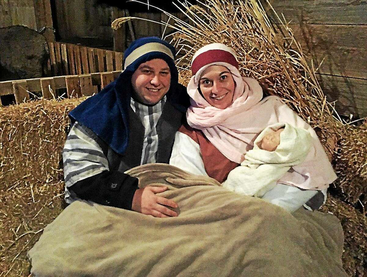 Screenshot via mlive.com: Joe Maurer and Kate Heinlein pose inside the stable during Immanuel Lutheran Church's annual Living Nativity event, which took place Dec. 5-7, 2014 in Frankentrost Township. (Courtesy: Joe Maurer)