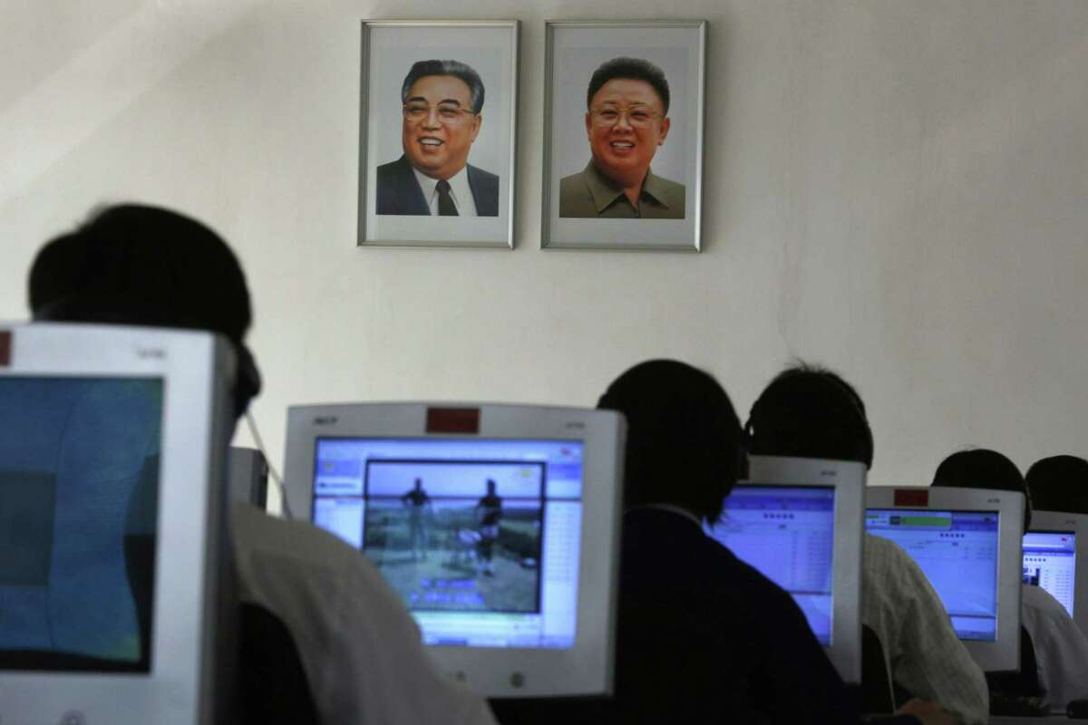 In this Sept. 20, 2012 photo, North Korean students use computers in a classroom with portraits of the country's later leaders Kim Il Sung, left, and his son Kim Jong Il hanging on the wall at the Kim Chaek University of Technology in Pyongyang, North Korea. Key North Korean websites were back online Dec. 23, 2014 after an hours-long shutdown that followed a U.S. vow to respond to a cyberattack on Sony Pictures that Washington blames on Pyongyang.
