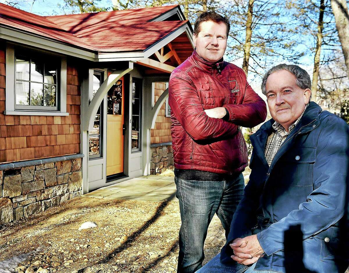 Architect Chris Arelt, standing, and homeowner Dennis Overfield at the renovated 2,200-square-foot cottage on Rogers Lake in Old Lyme.