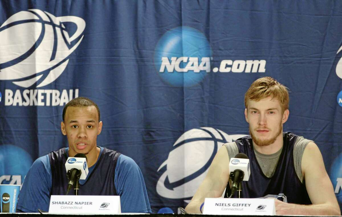 UConn's Shabazz Napier, left, and Niels Giffey respond to questions during a news conference in Buffalo, N.Y., on Friday. UConn plays Villanova in an NCAA tournament third-round game Saturday night.