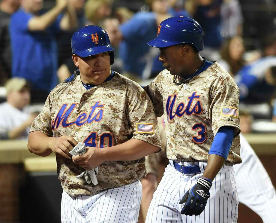 The Mets' Curtis Granderson (3) celebrates his two-run home run with Bartolo Colon, who also scored on the play. Photo: Kathy Kmonicek — The Associated Press  / FR170189 AP