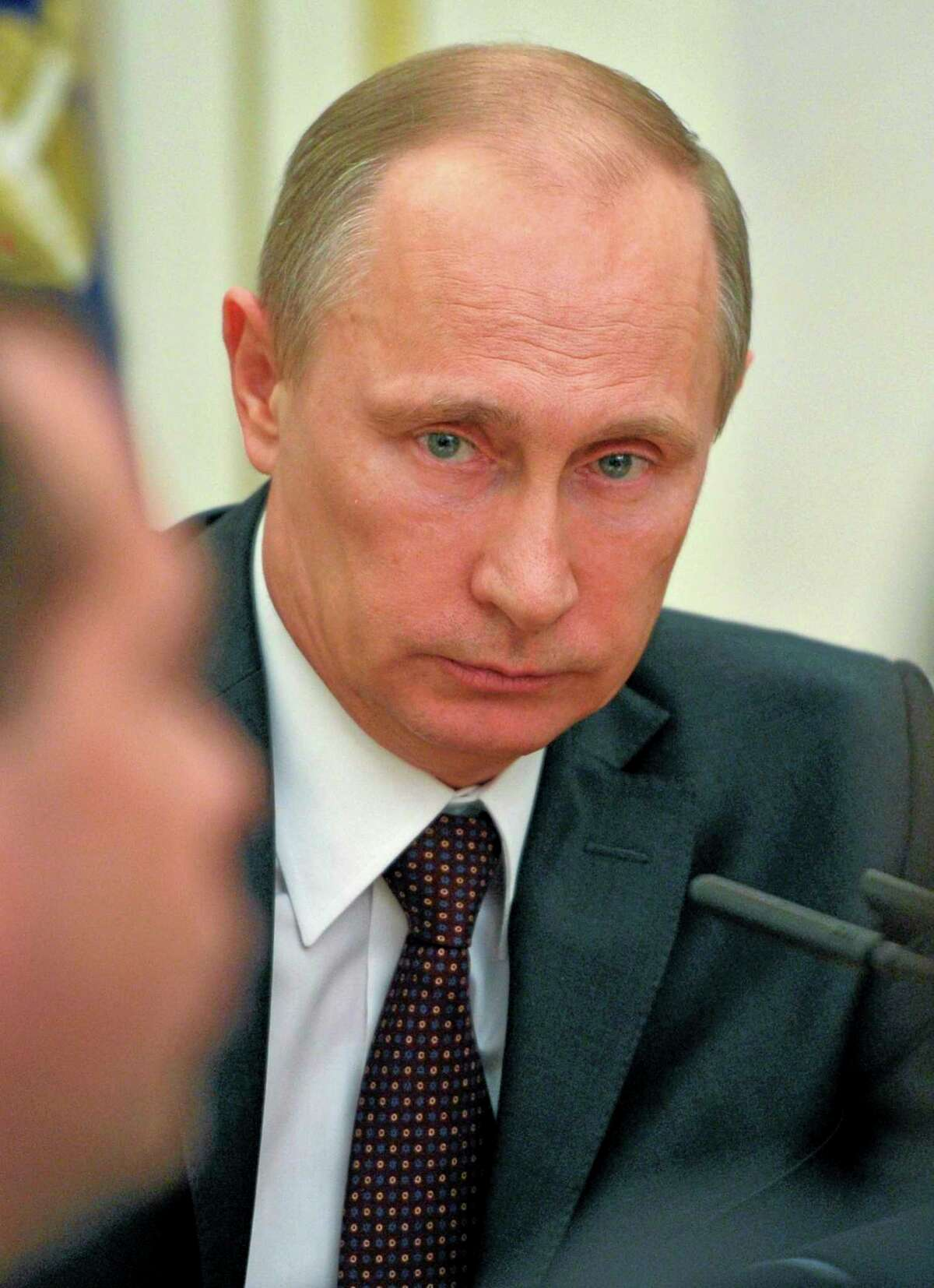 Russian President Vladimir Putin chairs a meeting with Security Council members in the Kremlin in Moscow, Russia, Friday. There is no need for Russia to further retaliate against U.S. sanctions, Putin said Friday as Russia's upper house of parliament endorsed the annexation of Crimea from Ukraine.