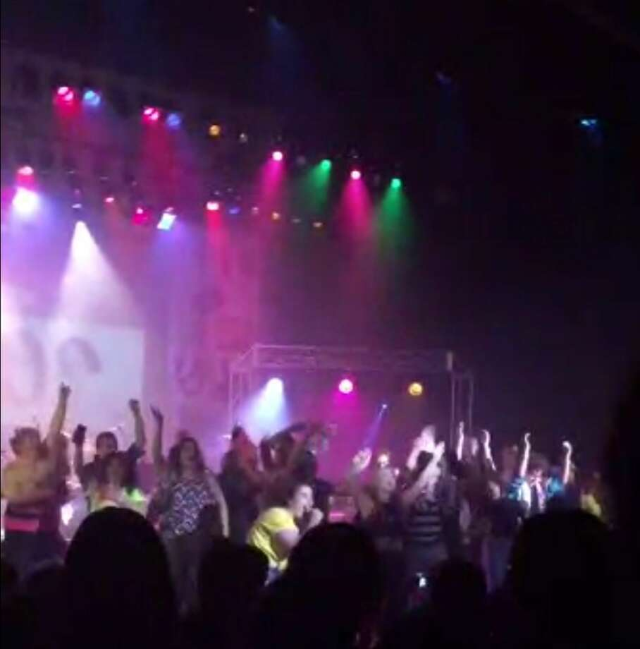 """In this image from video provided by Zach Rader students from Westfield High School are on the stage during the grand finale of the concert dubbed """"American Pie"""" Thursday April 23, 2015 just prior to the stage collapsed. More than a dozen students were injured after the stage filled with students collapsed during the musical performance at the central Indiana high school Thursday  night, authorities said. (Zach Rader via AP) Photo: AP / ZACH RADER"""
