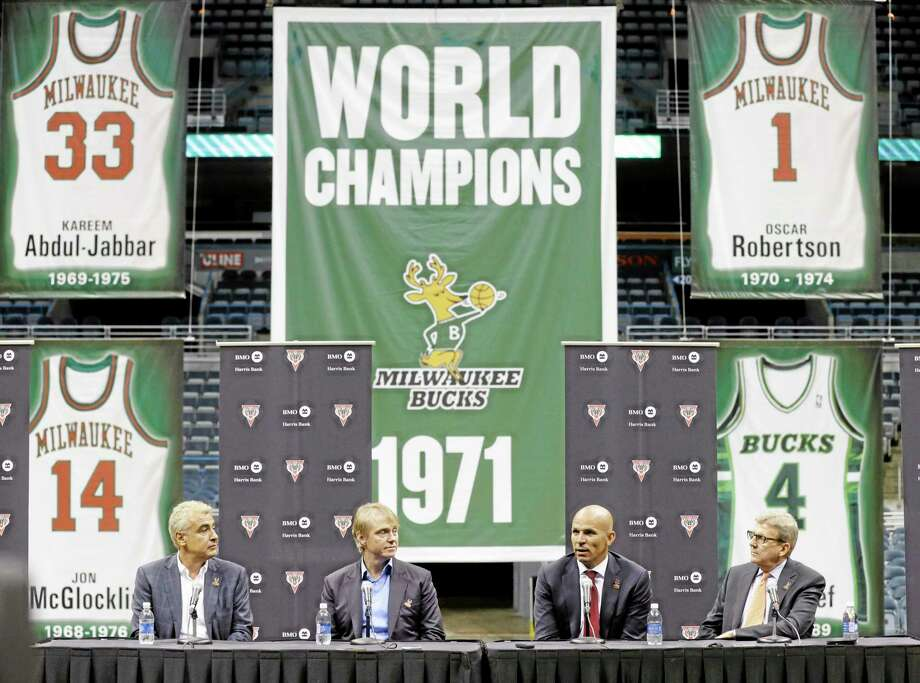 Jason Kidd, second from right, speaks after being named the new head coach of the Bucks on Wednesday in Milwaukee, as Bucks general manager John Hammond, right, listens with team co-owners Marc Lasry, left, and Wesley Edens. Photo: Jeffrey Phelps — The Associated Press  / FR59249 AP