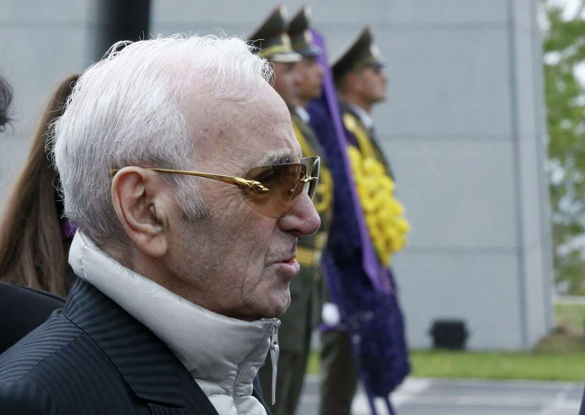 French singer Charles Aznavour attends a memorial service at the Tsitsernakaberd Armenian Genocide memorial complex in Yerevan, Armenia, Friday, April 24, 2015. Armenians on Friday marked the centenary of what historians estimate to be the slaughter of up to 1.5 million Armenians by Ottoman Turks, an event widely viewed by scholars as genocide. Turkey, however, denies the deaths constituted genocide and says the death toll has been inflated. (Vahan Stepanyan/PAN Photo via AP)