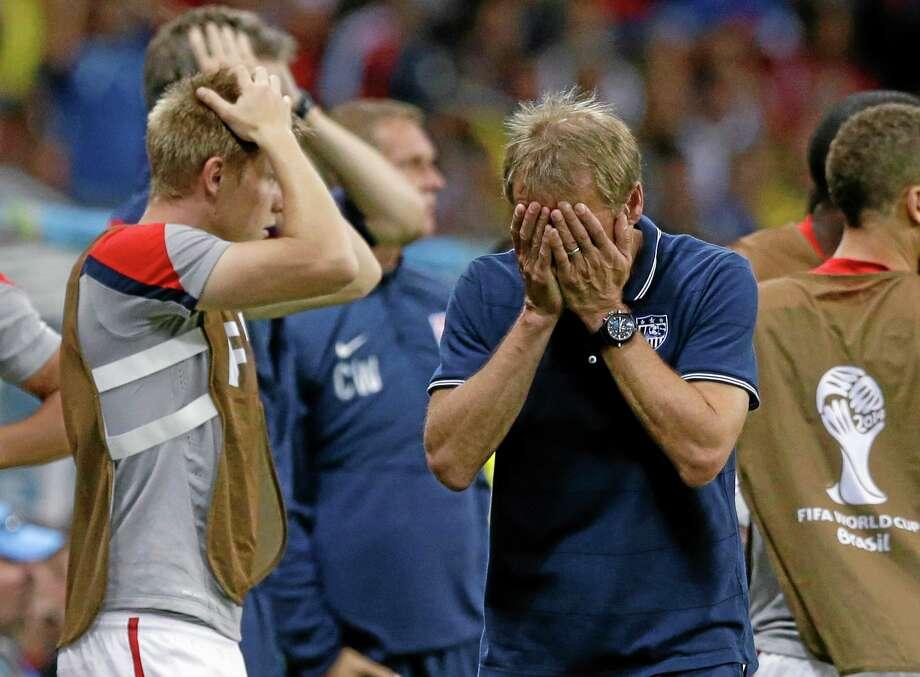 United States head coach Jurgen Klinsmann reacts during the World Cup match against Belgium Tuesday at the Arena Fonte Nova in Salvador, Brazil. Photo: Matt Dunham — The Associated Press  / AP