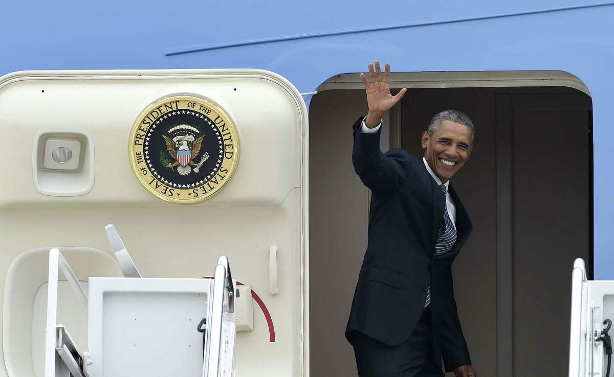 President Barack Obama waves from the top of the steps of Air Force One at Andrews Air Force Base in Md. on Aug. 31, 2015. Obama is traveling on a three-day trip to Alaska aimed at showing solidarity with a state often overlooked by Washington, while using its glorious but changing landscape as an urgent call to action on climate change.