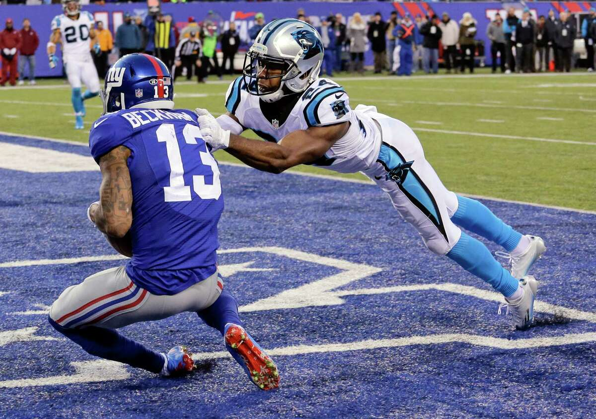 The Panthers' Josh Norman (24) tackles the Giants' Odell Beckham (13) in the end zone during Sunday's game.