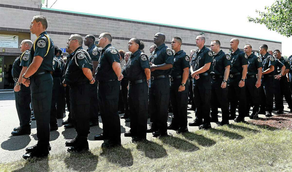 Members of the state Department of Correction class of 2014 prepare to march into their graduation program at the Malony Center for Training and Staff Development Tuesday.