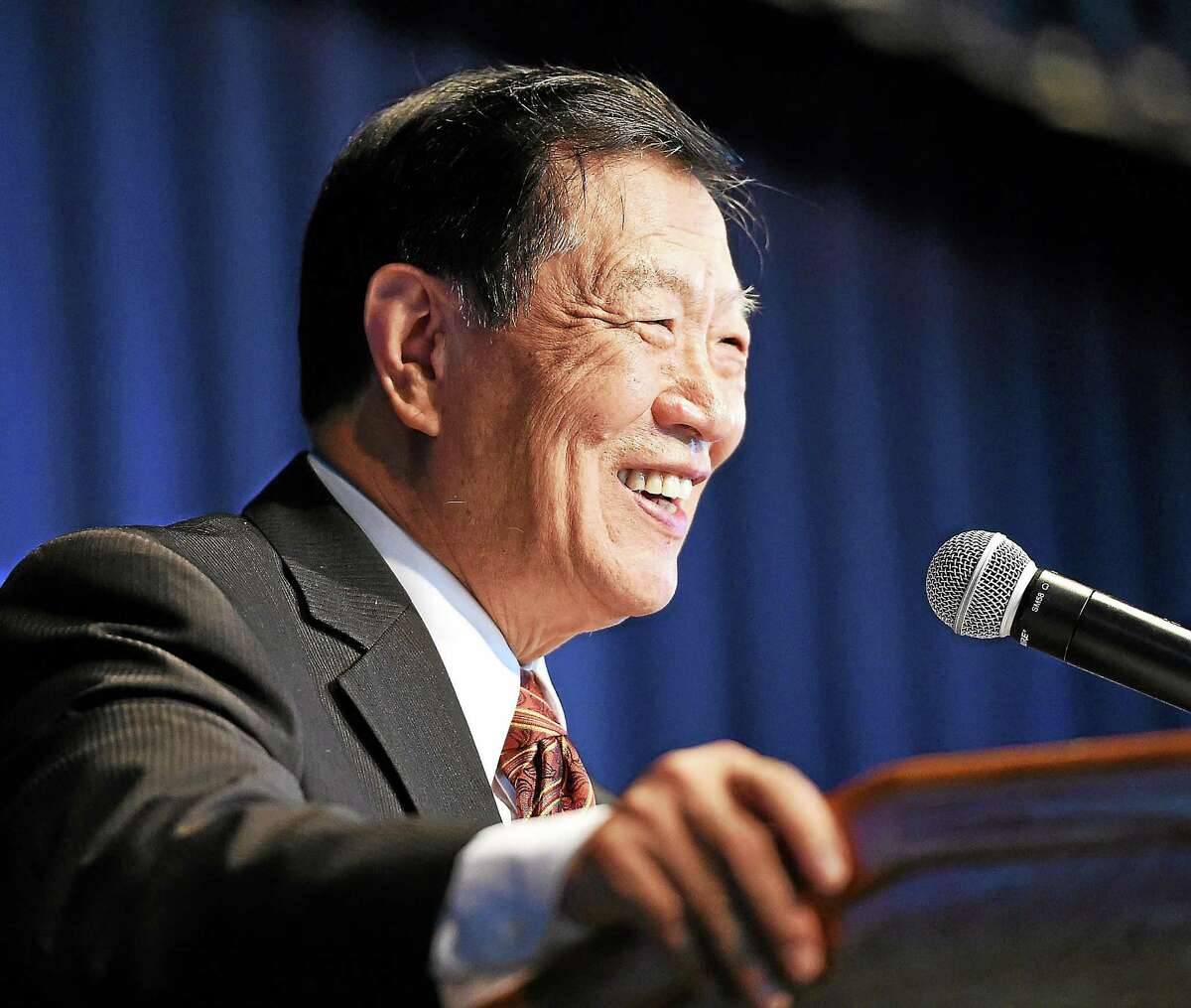 Henry C. Lee delivers the keynote address during Tuesday's Department of Correction graduation.