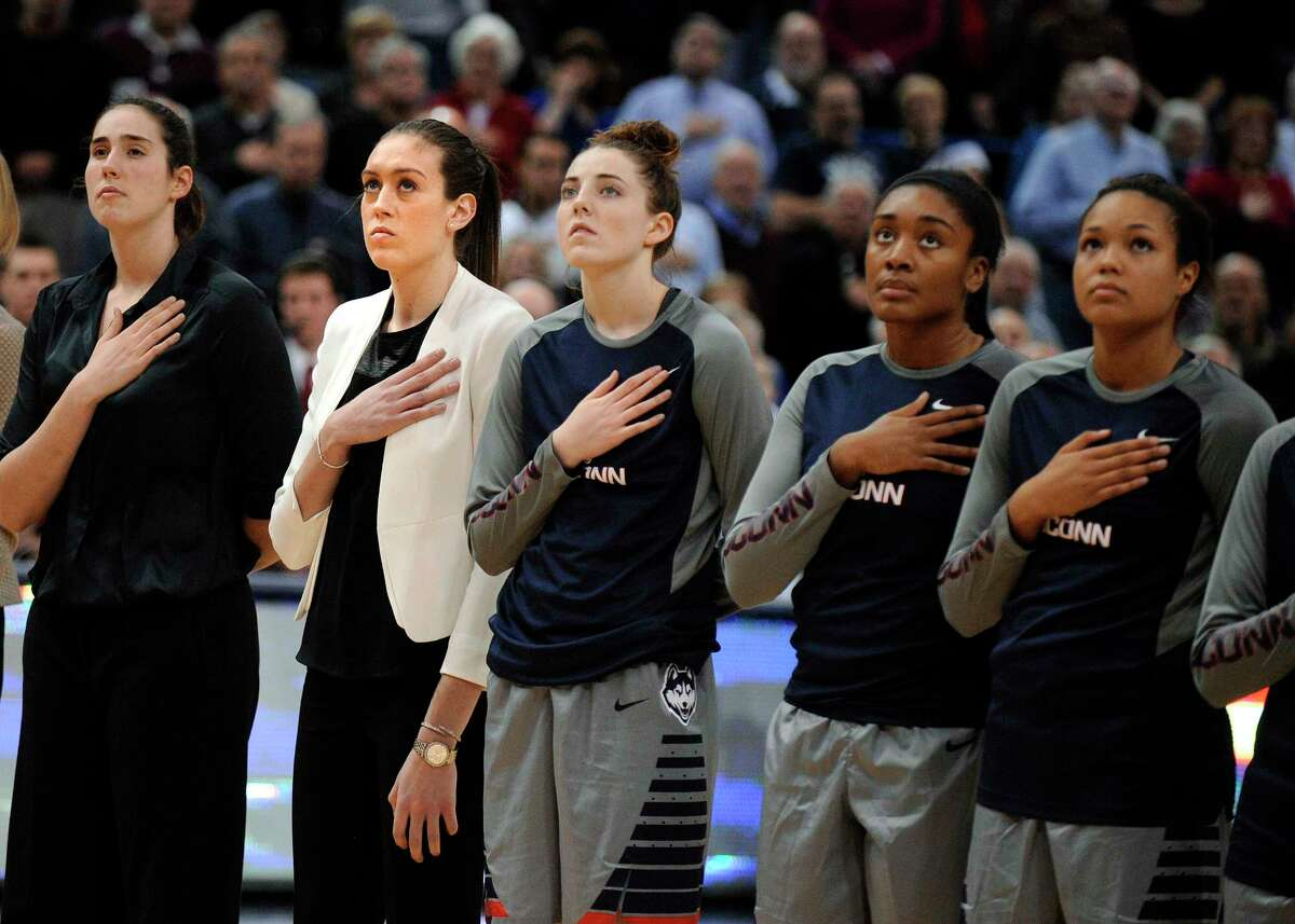 UConn's Breanna Stewart, second from left, listens to the national anthem with her teammates before Monday's game against LSU in Hartford.