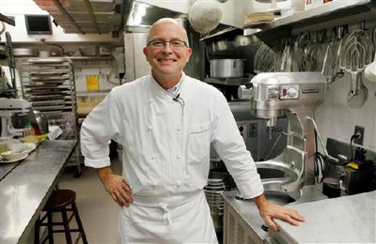 FILE- This Oct. 29, 2009 file photo shows White House pastry chef Bill Yosses as he poses in his kitchen during an interview with the Associated Press at the White House in Washington. Democrats and Republicans may follow their leaders in lockstep on the issues of the day, but when it comes to nuts _ specifically whether or not they belong in chocolate chip cookies _ it seems every politician is an island, says Yosses. (AP Photo/Charles Dharapak, FILE)