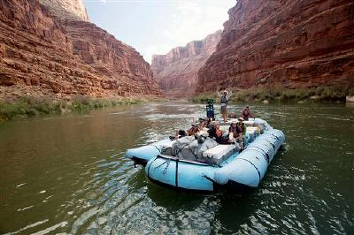 This August, 2013 photo provided by Google shows a frame from a moving time-lapse sequence of images of rafters on the Colorado River in Grand Canyon National Park., Ariz. Google has taken its all-seeing eyes on a trip that few ever get to experience - a moving tour of the river through the Grand Canyon courtesy of a Google time-lapse camera making sequential images. The search giant partnered with American Rivers to showcase the whitewater rapids, a handful of hiking trails, the towering red canyon walls and the stress placed on the river by drought and humans. The imagery taken last August went live Thursday, March 13, 2014. (AP Photo/Google)