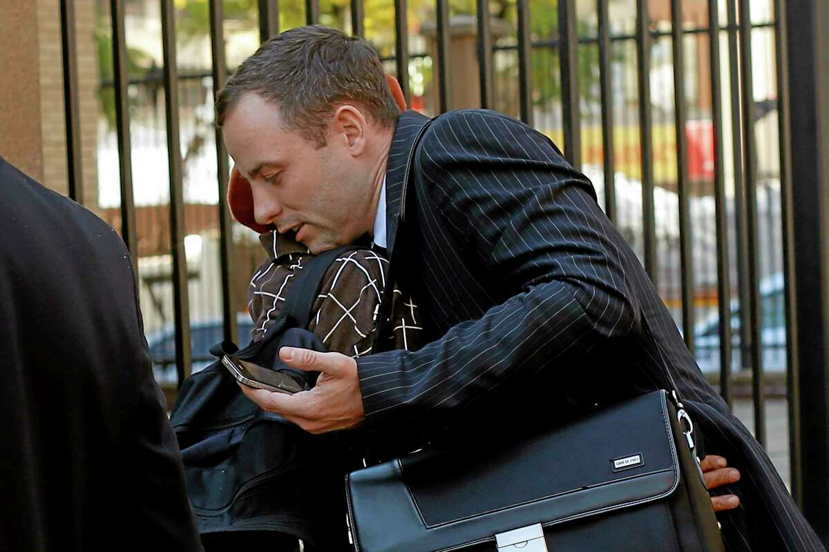 """Oscar Pistorius, hugs a well-wisher as he returns to court following a lunch break in Pretoria, South Africa, Wednesday, July 2, 2014. Pistorius is severely traumatized after killing girlfriend Reeva Steenkamp last year and will become an increasing suicide risk unless he continues to get mental health care, the judge overseeing his murder trial heard on Wednesday. Defense lawyer Barry Roux read excerpts from a psychologist's report that said the double-amputee runner is suffering depression and post-traumatic stress disorder and """"his condition is likely to worsen"""" if professional treatment for those conditions is halted. (AP Photo/Jerome Delay)"""