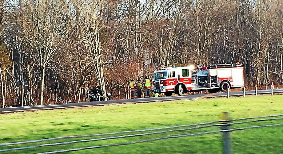 Interstate 91 north was closed down for a time as responders awaited the accident reconstruction team. Photo: Joe Amarante -- New Haven Register