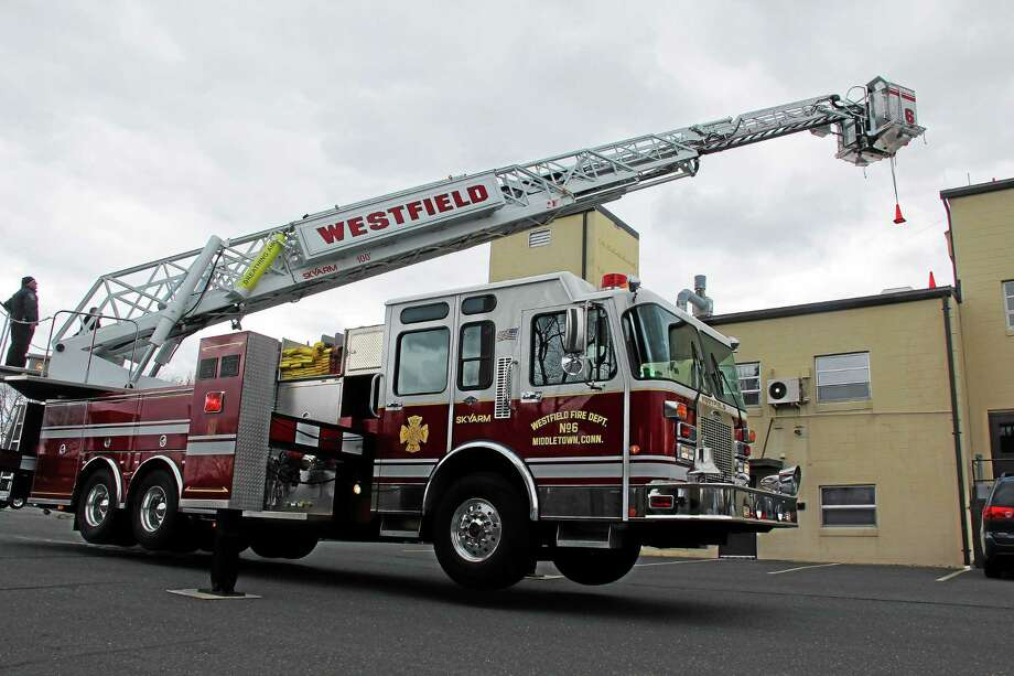 Westfield firefighters perform drills with an articulating 100-foot ladder truck on Thursday. The department is holding an open house from 11 a.m. to 2 p.m. on Sunday at 653 West Street in Middletown. Photo: Kathleen Schassler — The Middletown Press  / Kathleen Schassler All Rights