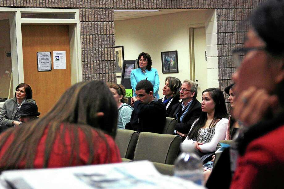 Middlesex Community College student and faculty enjoy student presentations during the school first academic convivium recently in Middletown. Photo: Phtoos By Kathleen Schassler — Middletown Press  / Kathleen Schassler All Rights