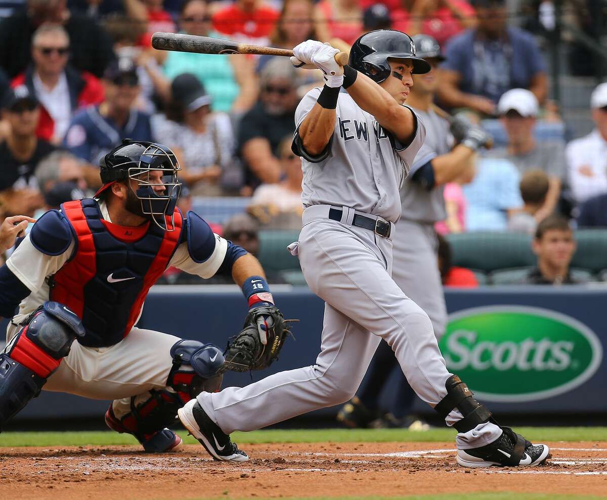 The Yankees' Jacoby Ellsbury, right, hits a three-run home run during the second inning Sunday.