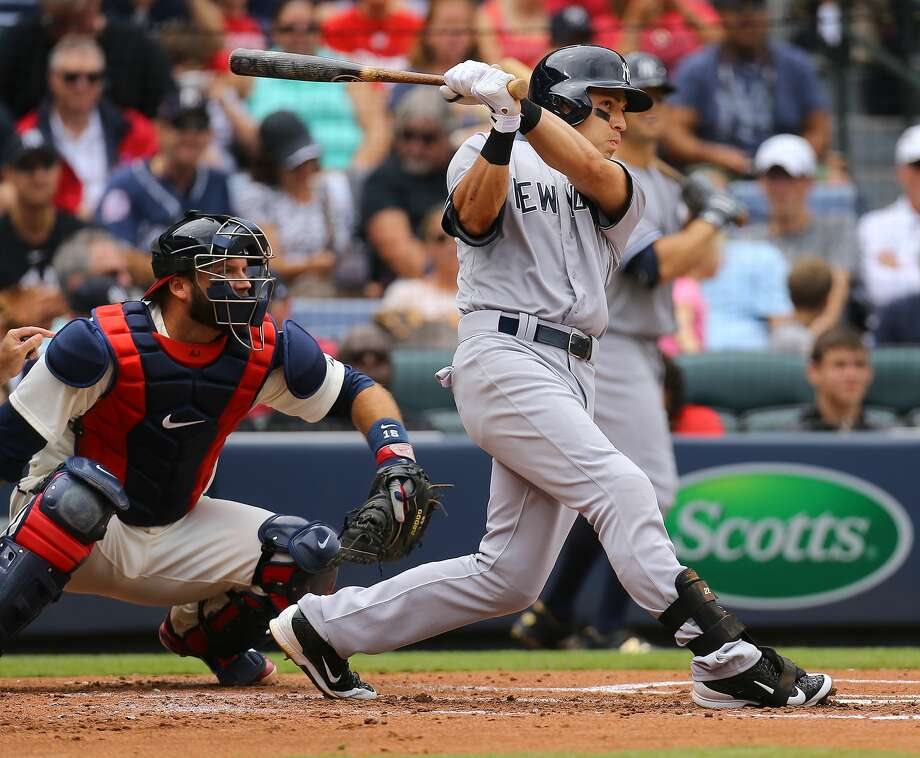 The Yankees' Jacoby Ellsbury, right, hits a three-run home run during the second inning Sunday. Photo: The Associated Press  / Atlanta Journal Constitution