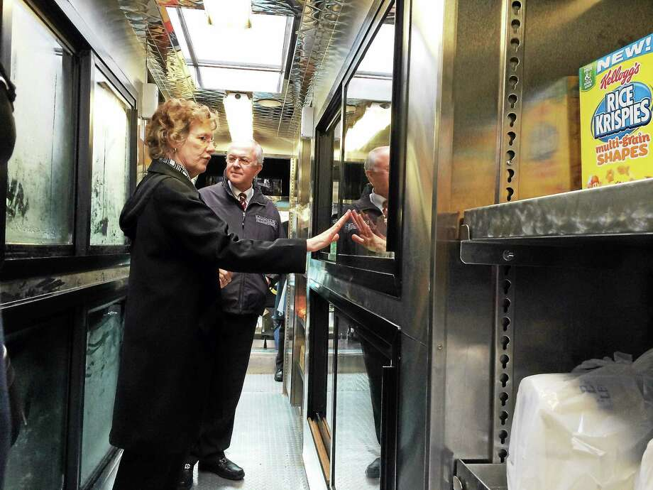 Knights of Columbus Supreme Knight Carl Anderson and Connecticut Food Bank CEO Nancy Carrington tour a special refrigerated food bank truck Tuesday at the Knights of Columbus headquarters in New Haven. The group donated $100,000 to the food bank Tuesday. Photo: (Wes Duplantier -- New Haven Register)