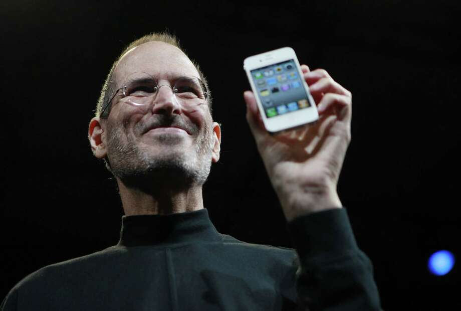 In this June 7, 2010, file photo, Apple CEO Steve Jobs holds a new iPhone at the Apple Worldwide Developers Conference in San Francisco. Photo: AP File Photo  / AP