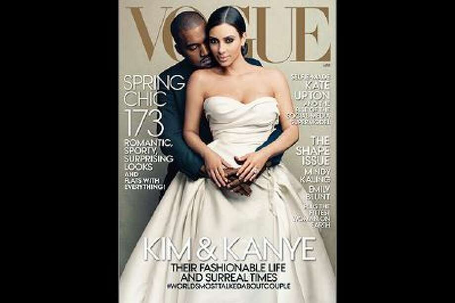 This cover image taken by Annie Leibovitz for Vogue shows the April 2014 issue of the high fashion magazine featuring rapper Kanye West and TV personality Kim Kardashian. The April issue hits newsstands nationwide on March 31 and will be available on March 24 as a digital download for tablets. (AP Photo/Vogue, Annie Leibovitz) Photo: AP / AP2014