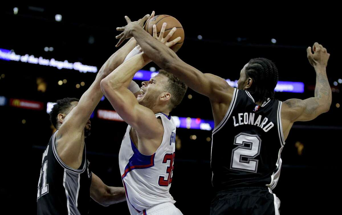 The San Antonio Spurs' Kawhi Leonard, right, was named the NBA Defensive Player of the Year.
