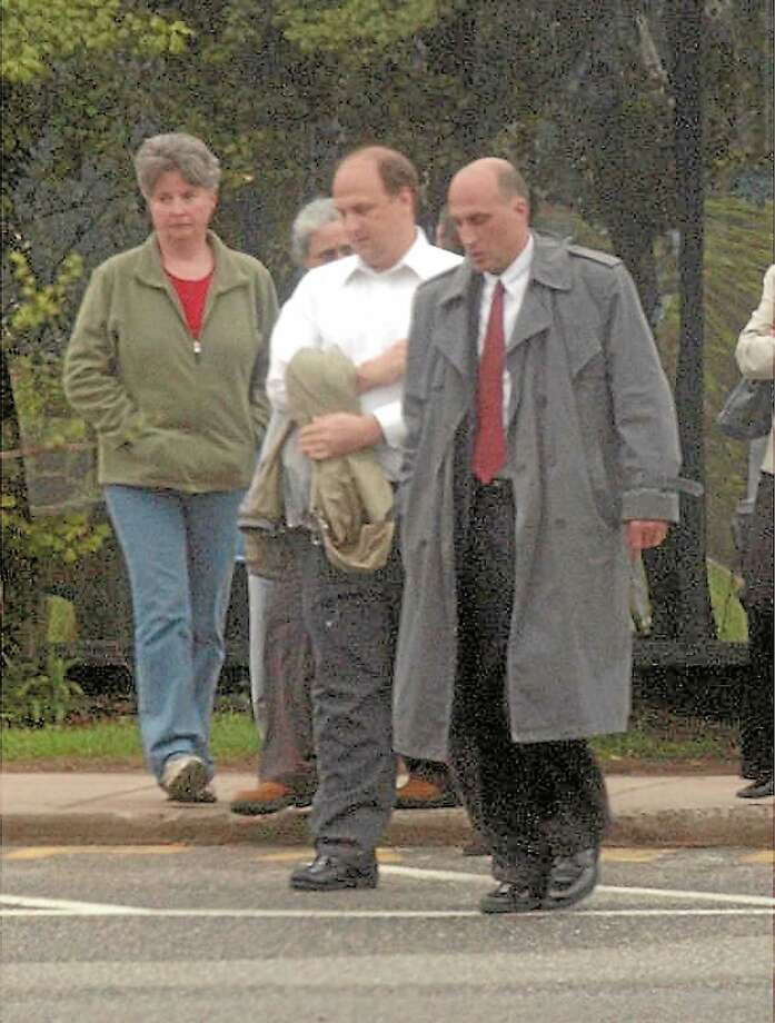 Peter Sebben, in coat, walks out of Litchfield court in an undated file photo. Photo: Register Citizen File Photo