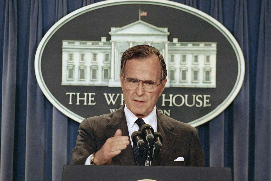 FILE - In this Thursday, May 11, 1989, file photo, President George H.W. Bush briefs reporters at the White House in Washington. Former President George H.W. Bush was taken to a Houston hospital after experiencing a shortness of breath on Tuesday, Dec. 23, 2014. (AP Photo/Doug Mills, File) Photo: AP / AP
