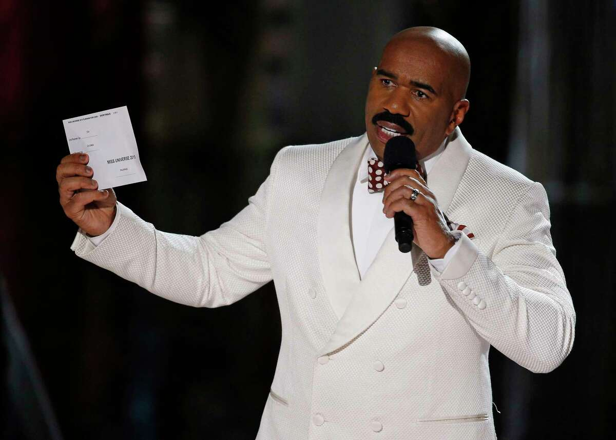 Steve Harvey holds up the card showing the winners after he incorrectly announced Miss Colombia Ariadna Gutierrez at the winner at the Miss Universe pageant Sunday in Las Vegas.