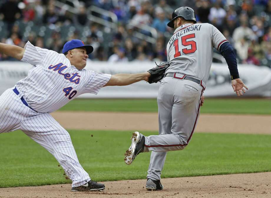 Mets starter Bartolo Colon tags out the Atlanta Braves' A.J. Pierzynski during the sixth inning of Thursday's win in New York. Photo: Frank Franklin II — The Associated Press  / AP