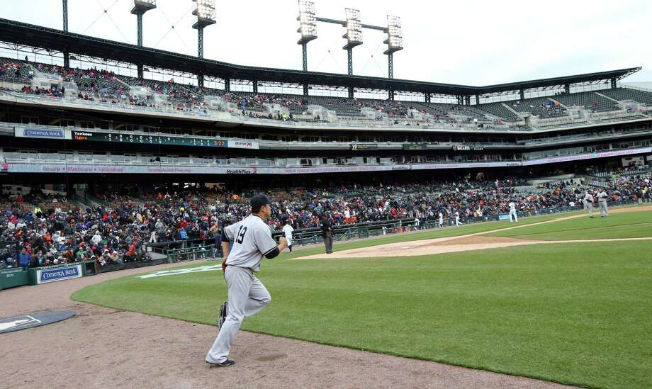 New York Yankees starter Masahiro Tanaka runs out onto the Comerica Park field to start the seventh inning of Thursday's game against the Tigers in Detroit. Photo: Carlos Osorio — The Associated Press  / AP
