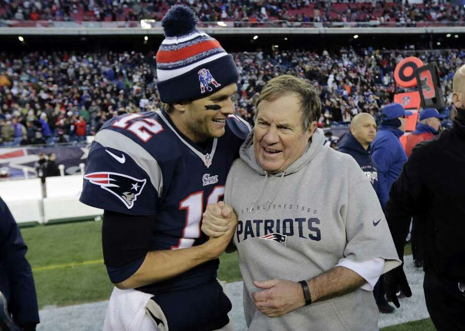 Patriots quarterback Tom Brady, left, with head coach Bill Belichick after a game earlier this season. Photo: The Associated Press  / AP