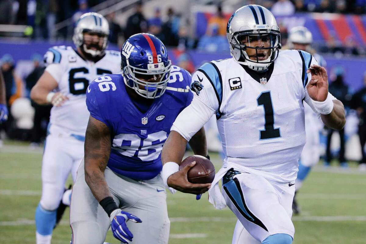 The Panthers' Cam Newton (1) runs away from the Giants' Jay Bromley during the second half Sunday.