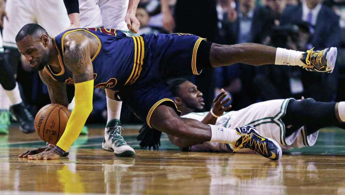 Cleveland Cavaliers forward LeBron James hits the floor after colliding with Celtics forward Jae Crowder during the second quarter of Thursday's game in Boston.
