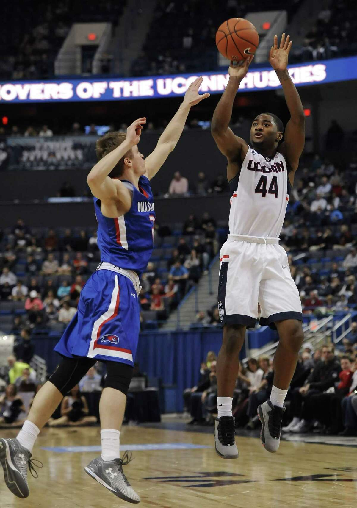 UConn's Rodney Purvis, right, shoots over UMass-Lowell's DJ Mlachnik, left, in the second half of Sunday's game in Hartford.