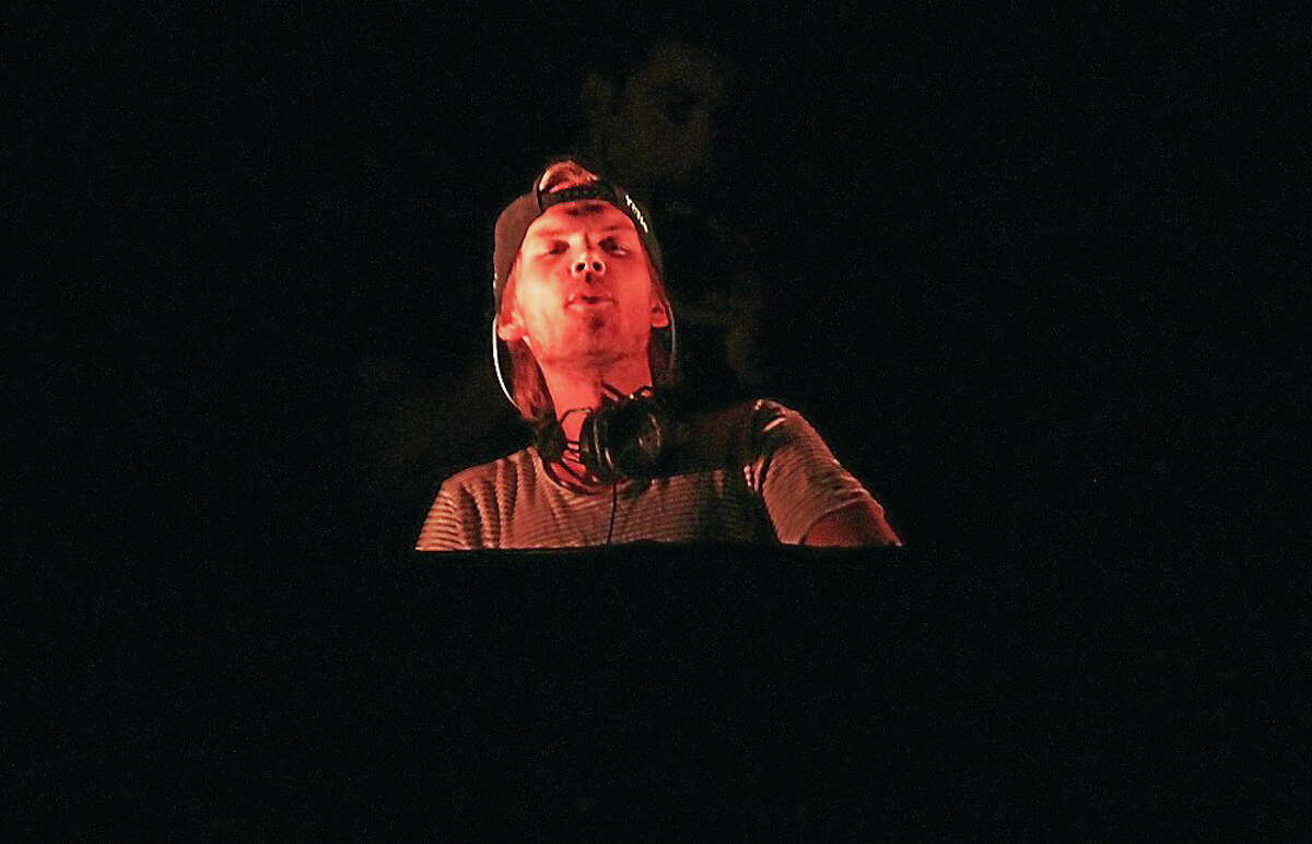 """Swedish DJ, remixer, and record producer Tim Bergling, better known by his stage name Avicii, is shown in action during a """"live"""" concert appearance."""