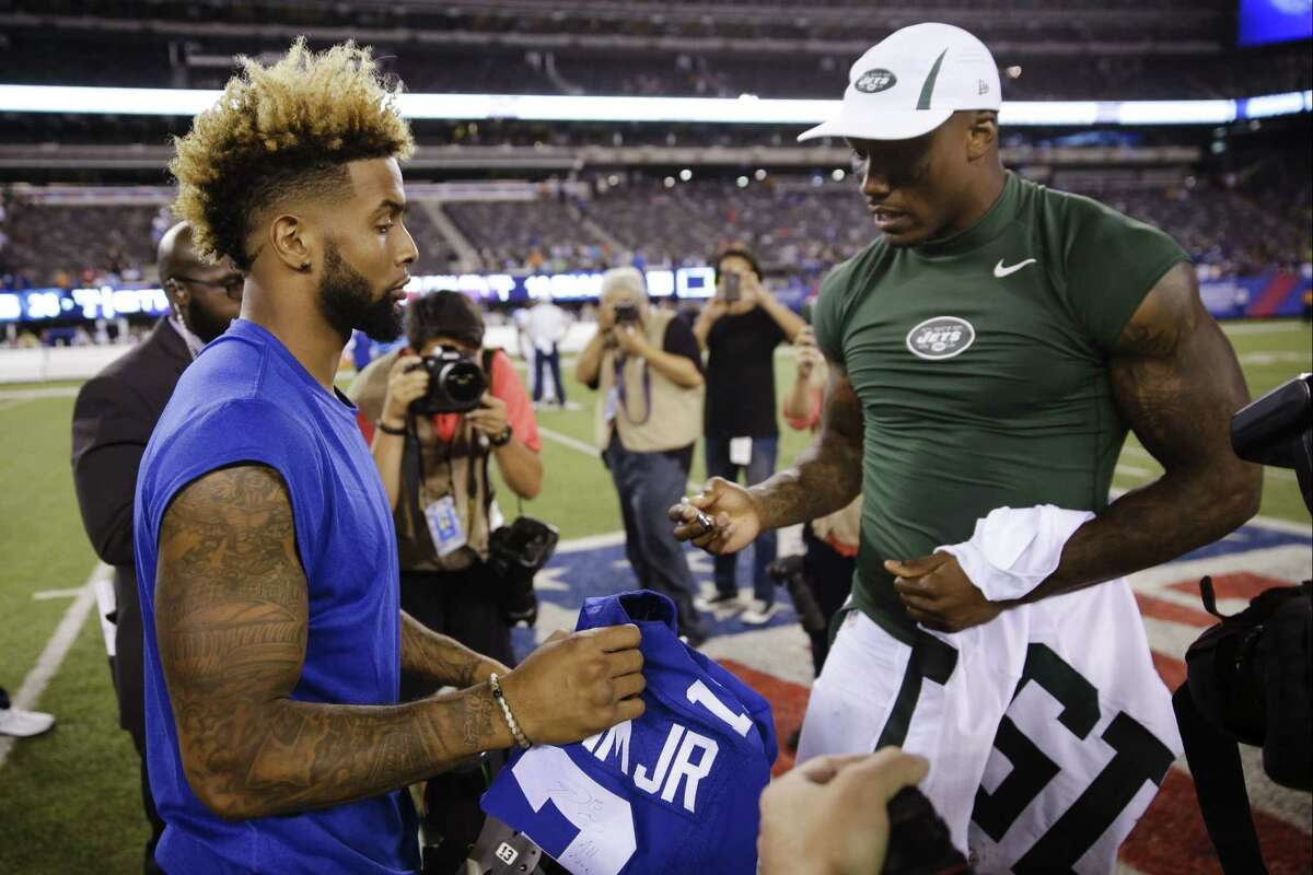 New York Giants receiver Odell Beckham, left, and New York Jets receiver Brandon Marshall, right, exchange jerseys after Saturday's preseason game in East Rutherford, N.J. The Jets won 28-18.