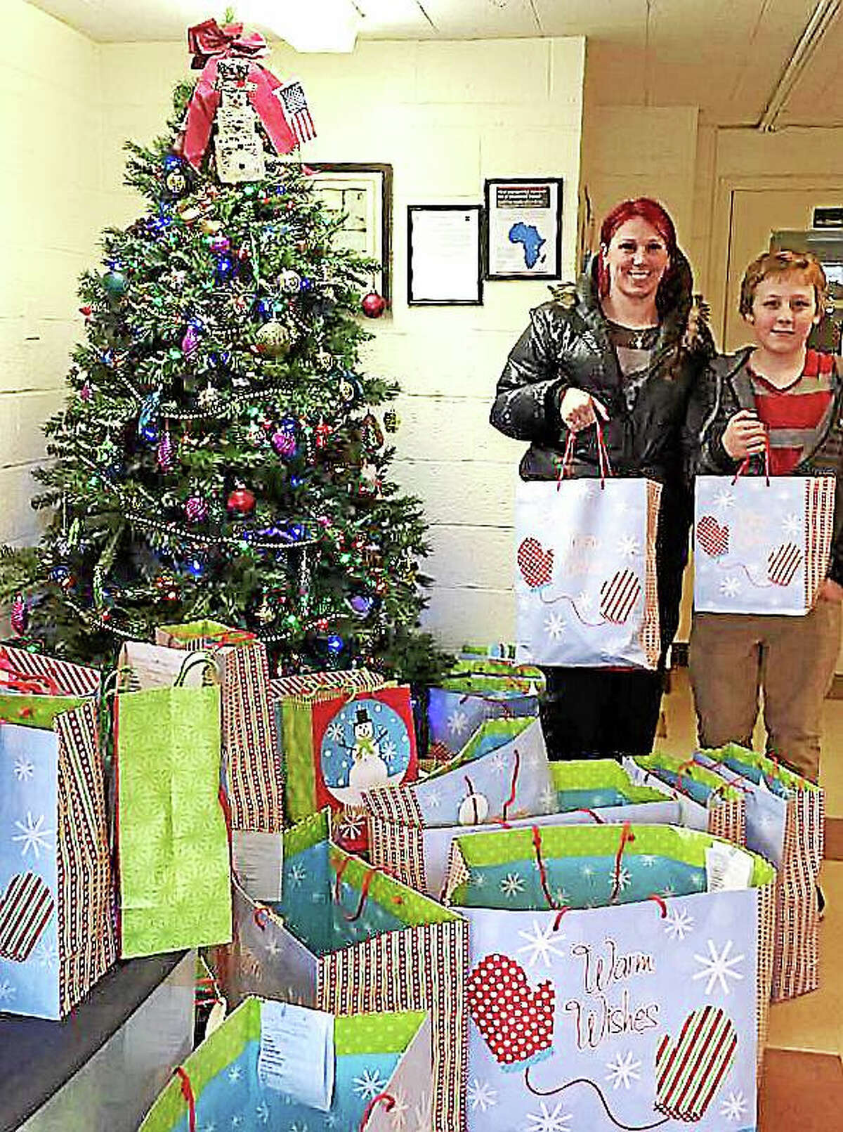 file Libby Carrier and her son delivered gift bags locally last year in an effort to honor her brother, Conrad Cook. Cook, who died while homeless and suffering from an untreated mental illness.