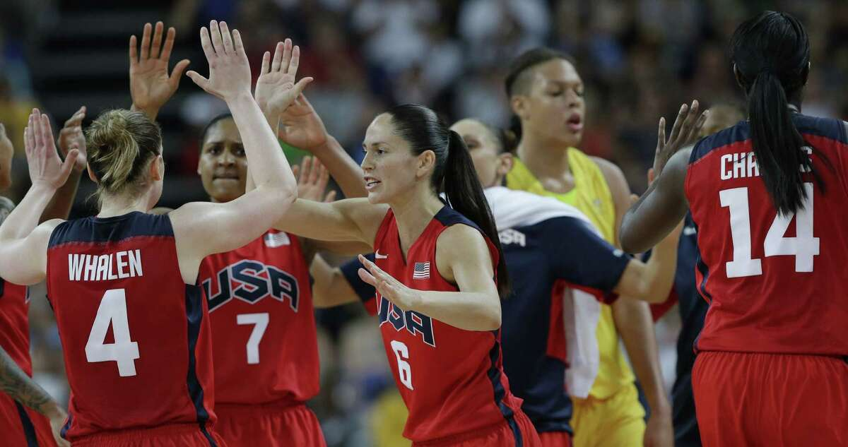 Sue Bird (6) celebrates with teammates Lindsay Whalen (4) and Maya Moore (7) during a semifinal women's basketball game against Australia at the 2012 Summer Olympics. Bird is the Middlesex County Chamber of Commerce 2016 Role Model of the Year Award honoree.