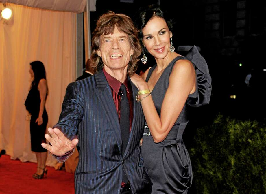 FILE - This May 7, 2012 file photo shows singer Mick Jagger, left, and L'Wren Scott at the Metropolitan Museum of Art Costume Institute gala benefit, celebrating Elsa Schiaparelli and Miuccia Prada, in New York. Scott, a fashion designer, was found dead Monday, March 17, 2014, in Manhattan of a possible suicide. (AP Photo/Evan Agostini, File) Photo: AP / AGOEV