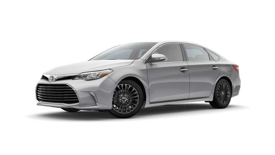The Touring version of Toyota's flagship sedan sports a black grille, LED headlights and running lights Photo: Toyota