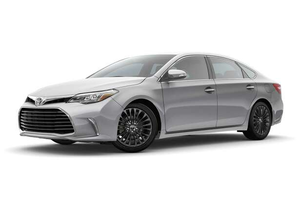 The Touring version of Toyota's flagship sedan sports a black grille, LED headlights and running lights